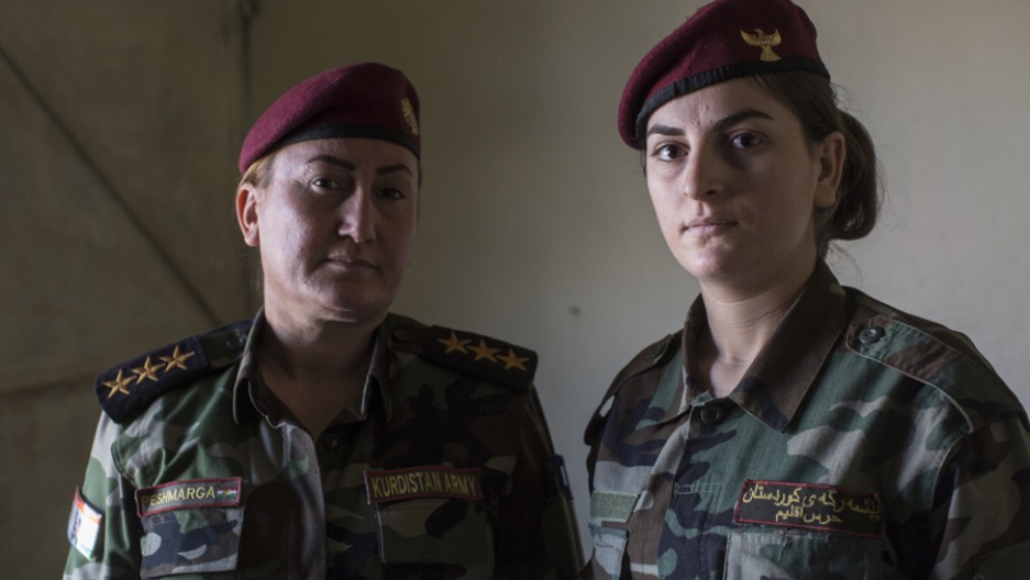 Capt. Khatoon Khider, left, commander of the all-female Yazidi Sun Brigade, with her sister, Aliya, in a home near the city of Dohuk, in Iraqi Kurdistan, on Sept. 24.